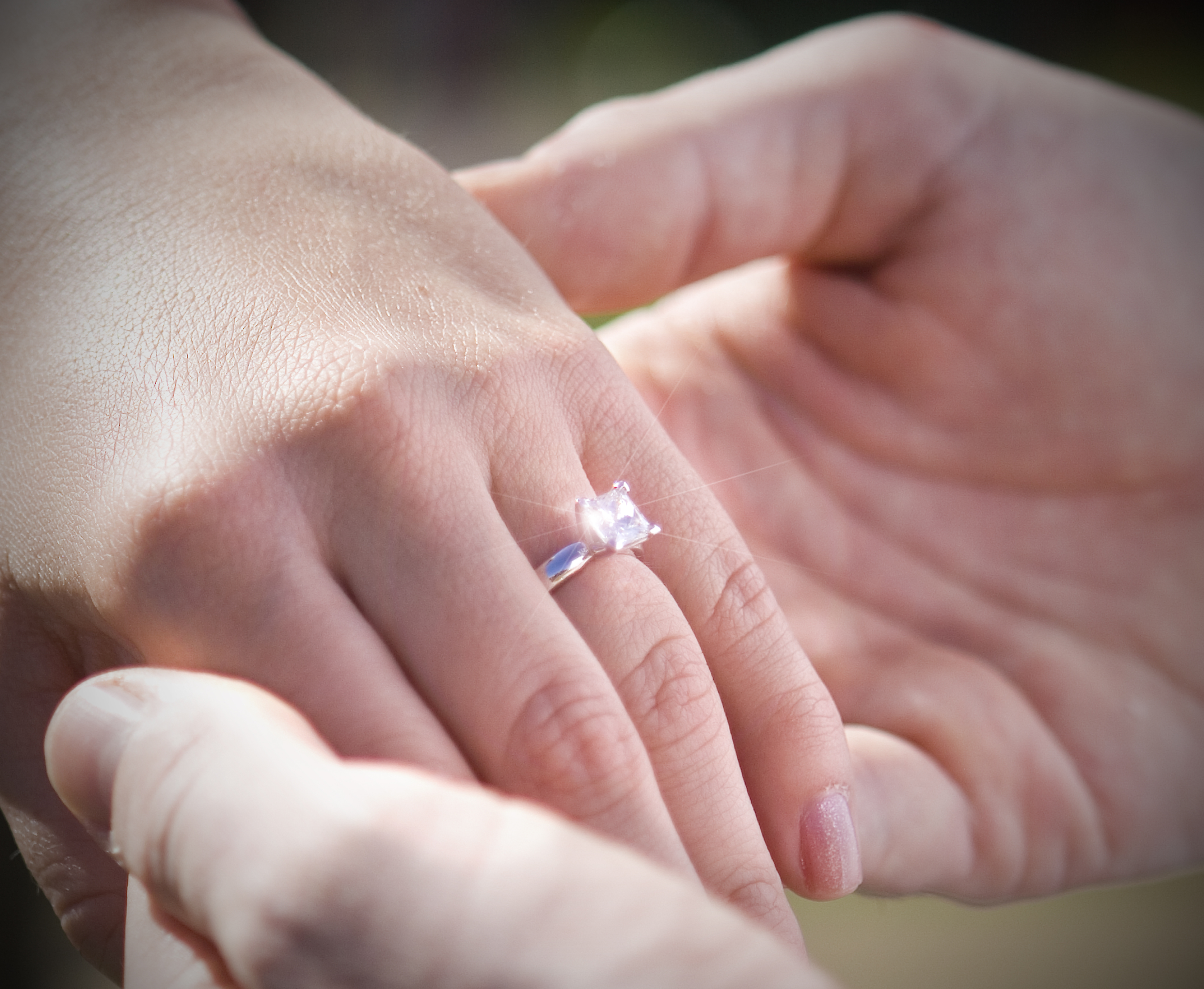 A newly engaged couple showing off the engagement ring | Bloomwood ...