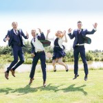 Groom, best man and ushers, jumping