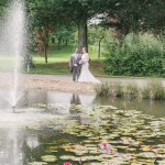 Wedding couple, pond, water fountain