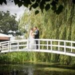 Kiss on bridge, High House weddings