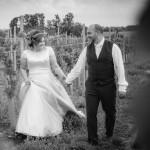 Wedding couple, vineyard walk