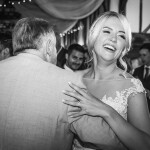 Bride dancing, smiling bride, black and white photo, bride and father